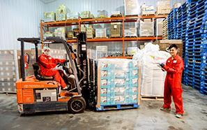 Workers in a warehouse with forklift