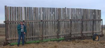 Discer frames salvaged and bolted together for bottom fence support
