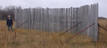 Fence with three sections permanently hinged together