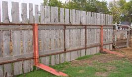 Fence with angle iron on support legs