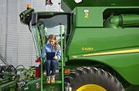 Young worker on a combine
