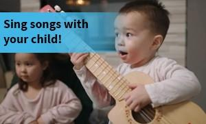 Child singing and playing guitar