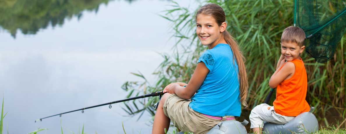 Girl and boy fishing