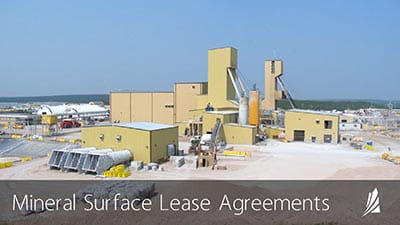 "An image showing a mining operation in northern Saskatchewan, with text that reads ""Mineral Surface Lease Agreements."""