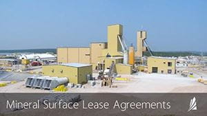 """An image showing a mining operation in northern Saskatchewan, with text that reads """"Mineral Surface Lease Agreements."""""""