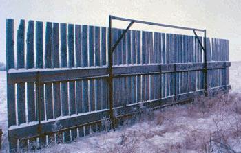 Steel tubing at top of fence